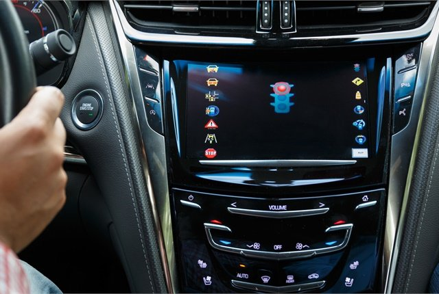 Using vehicle-to-infrastructure (V2I) communications, Cadillac CTS development vehicles alert drivers of potential red light violations via the infotainment system. Photo courtesy of Cadillac.