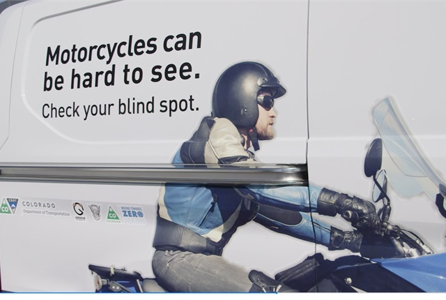 The vehicle wrap on a Groove Auto fleet vehicle remindsmotorists to watch for motorcyclists. Photo courtesy ofthe Colorado Department of Transportation.