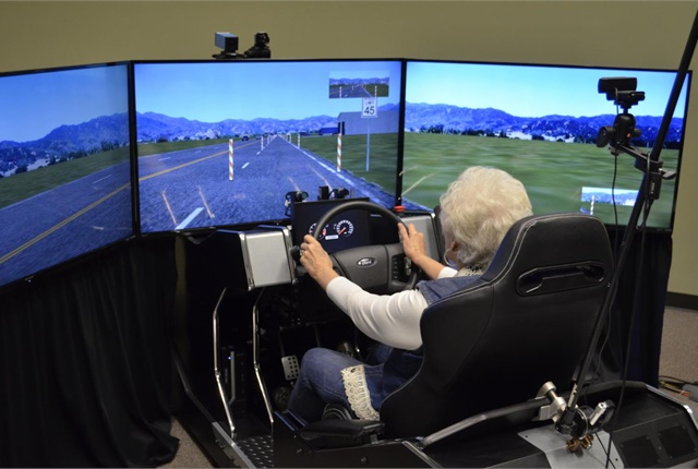 One of the study's 59 volunteers sits in a high-fidelity driving simulator. Photo by Malcolm Dcosta. Photo courtesy of the University of Houston.