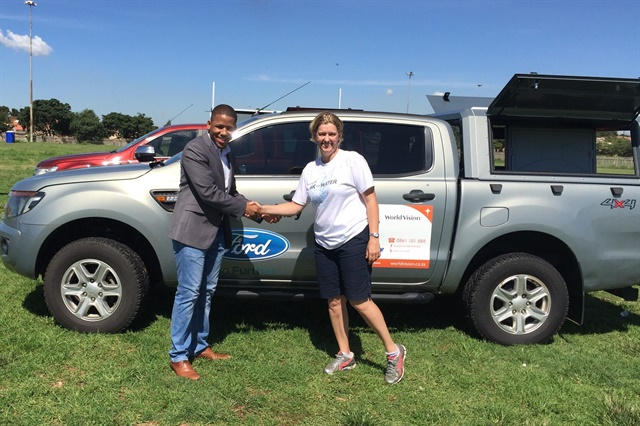 Ensly Dooms from Ford Southern Africa and Paula Barnard, ND of World Vision SA at the official handover of the Ford Rangers in Soweto, Johannesburg. Photo: Ford