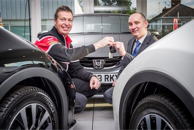 Honda Yuasa Racing driver, Matt Neal (left) handing over the keys to Scott Saxby, Financial Adviser, Forester Life