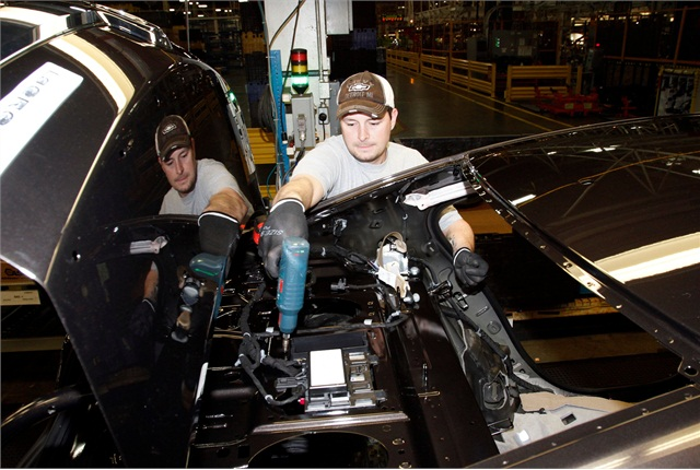 Scott Hayes secures the battery in a Chevrolet Malibu Hybrid at the General Motors Fairfax Assembly and Stamping Plant Monday, January 28, 2013 in Kansas City, Kansas. The Fairfax plant produces the Buick LaCrosse and the Malibu. Photo courtesy GM.