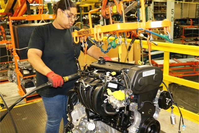 A worker dresses a Chevrolet Sonic engine at Orion Assembly Plant. Photo courtesy of GM.