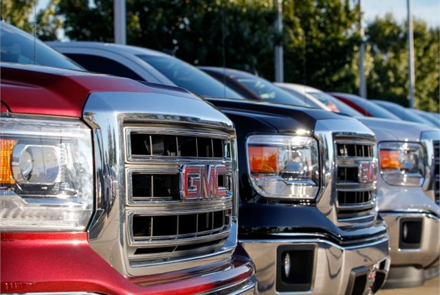 Photo of GMC trucks on dealer lot courtesy of GM.