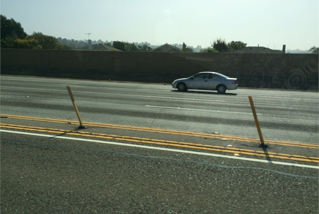 <p><strong><em>Some freeways have added physical barriers, such as poles, to discourage illegal lane changes into HOV/HOT lanes.</em></strong></p>