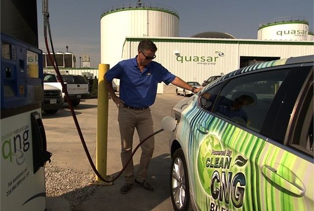 The bi-fuel CNG Impala is filled up by a Quasar associate in Ohio. Photo courtesy of GM.