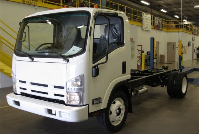 Photo of 20,000th gasoline NPR cabover courtesy of Isuzu.