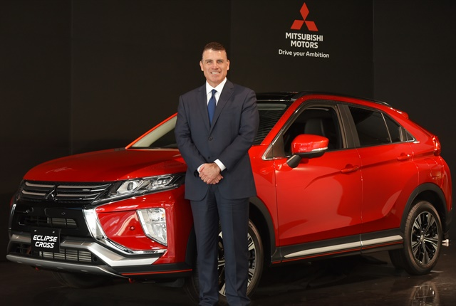 Photo of Fred Diaz with the Eclipse Cross courtesy of Mitsubishi.
