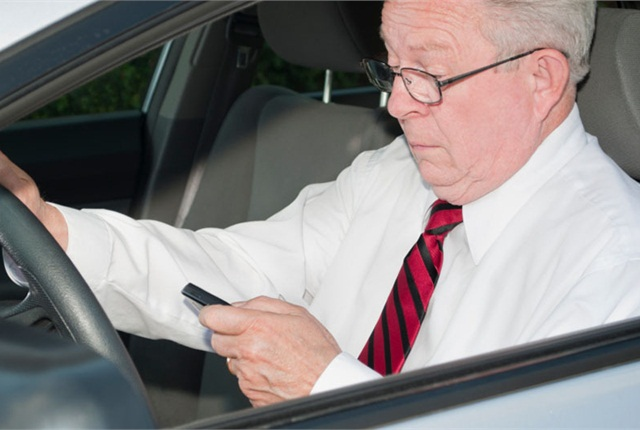 Smart phones are now widely used by all age groups, and the common temptation to sneak a peek behind the wheel poses a major safety concern. Photo: State Farm.