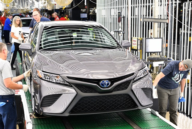 Photo of one of the first 2018 Camry sedans rolling off the line courtesy of Toyota.