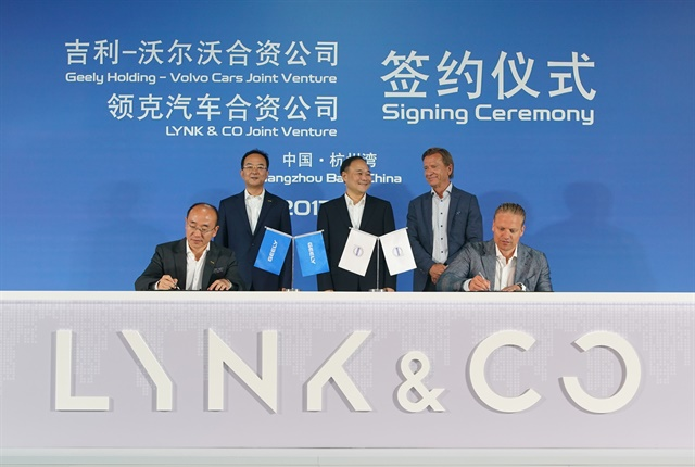 Photo of joint venture signing courtesy of Volvo.