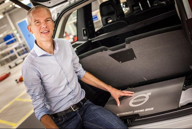 <p><em>Erik Coelingh, senior technical leader at Volvo Cars, with the very first autonomous XC90 and the Autonomous Driving Brain that will be used in the Drive Me project in Gothenburg. Photo courtesy of Volvo.</em></p>