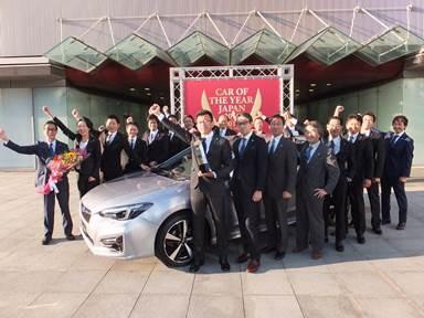 Subaru Impreza chief engineer Kazuhiro Abe celebrates the Impreza'shonor as Japan's COTYwith designers, engineers, and PR communications staff. Photo: Japan COTY