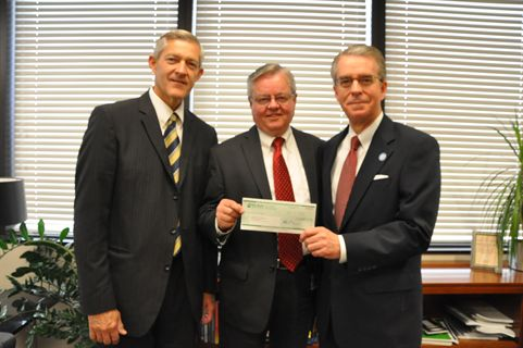 (L-R) Dallan Sohm, director of Fleet and Food Services; Michael Sims, fleet operations manager; and J. Lawrence Richards, president of LDS Business College, are employees of the Church of Jesus Christ of Latter-Day Saints. Sims (center) selected LDS Business College as the recipient of a $5,000 scholarship check.