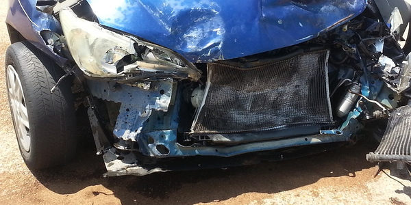 Photo of car involved in a frontal collision viaPixabay.