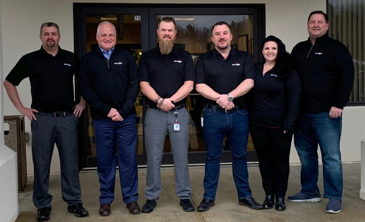 Chris Johnson (third from left) joins Merchants Fleet as a truck equipment engineer.