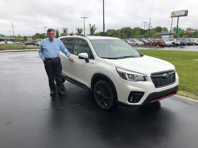 Charles Reed, Subaru's first-ever fleet sales manager, will retire on Jan. 4 after more thanthree decades on the job.  - Photo by Mike Antich.