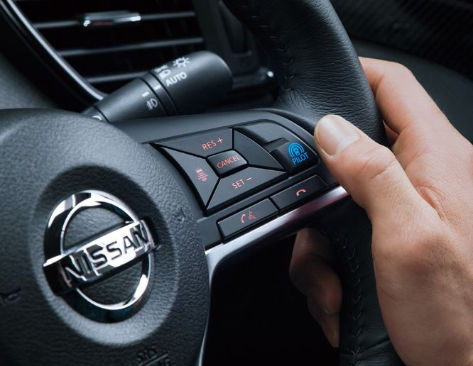 Photo of semi-autonomous ProPilot steering wheel button courtesy of Nissan.