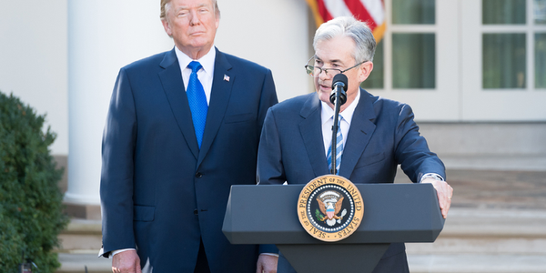 Jerome Powell, seen here with Donald Trump in 2017, has faced pressure from the president and...