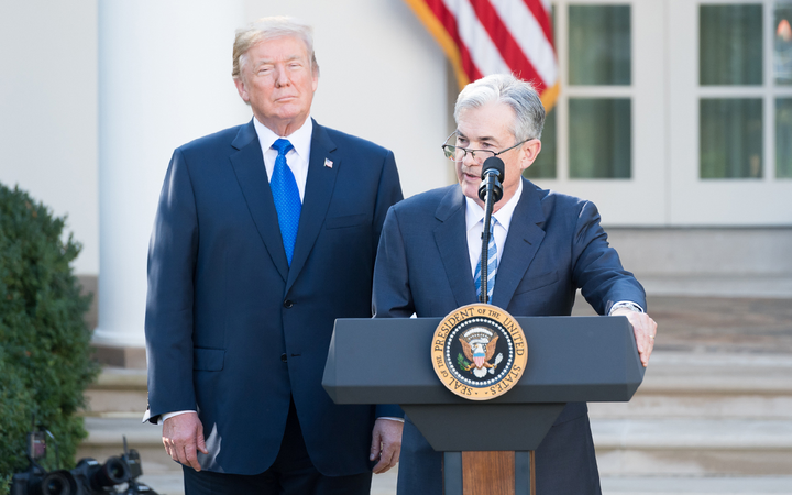Jerome Powell, seen here with Donald Trump in 2017, has faced pressure from the president and others to reverse course on planned interest-rate hikes.