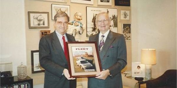 Bob Brown (left), Great Lakes sales manager, presents a framed Automotive Fleet cover to Lee...