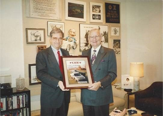 Bob Brown (left), Great Lakes sales manager, presents a framed Automotive Fleet cover to Lee Iacocca in 1981 around the launch of the K-car platform.