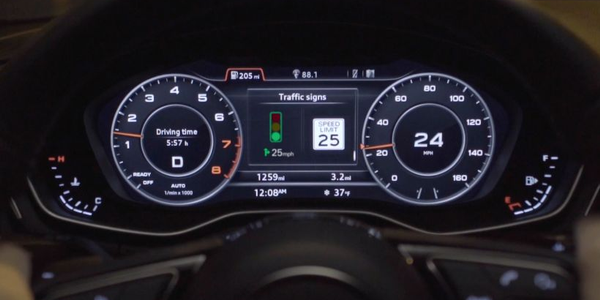 New connected-vehicle technology from Audi lets drivers know how fast to drive to make a green...