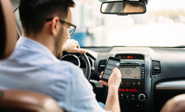 Under a proposed law, Utah drivers could be pulled over for holding their phones.