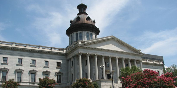A South Carolina House subcommittee has approved a bill banning drivers from any handheld use of...