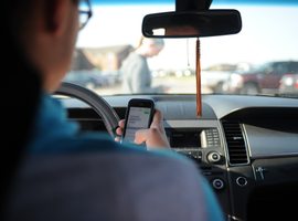 Cities in Arizona and Michigan have passed distracted driving laws that are more strict than ones passed at the state level.
