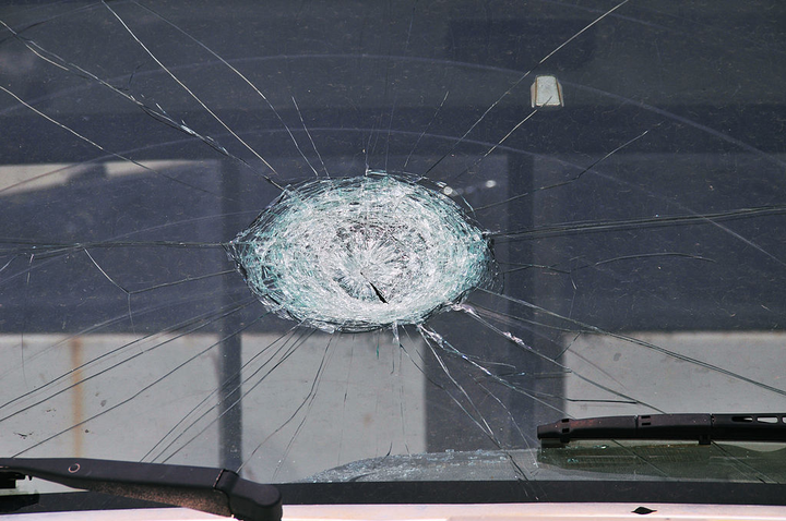 Large pieces of hail falling from the sky can cause dents and broken windshields when they strike vehicles.