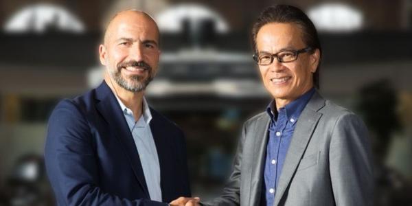 Dara Khosrowshahi, Uber's CEO (left) andShigeki Tomoyama, executive vice president of Toyota...