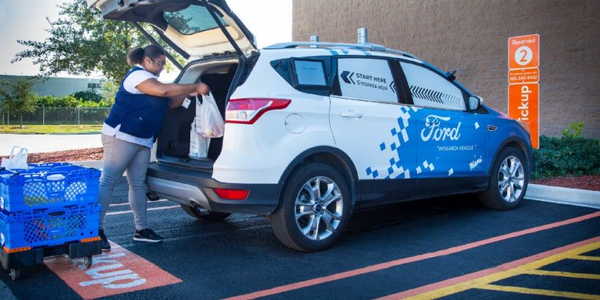 Walmart and Ford are testing an autonomous vehicle delivery program through Postmates to deliver...