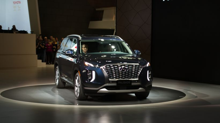 The all-new Hyundai Palisade offers three rows of seating and is built atop an all new chassis.  All of the vehicle's exterior dimensions, such as length, width, height, and wheelbase beat out the dimensions of the company's previously largest vehicle: the 2019 Hyundai Santa Fe XL.