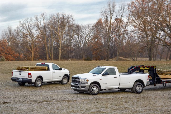 The 2019 Ram 2500 (left) and Ram 3500 will arrive in the second quarter with an array of updates, including a high-output 6.7-liter Cummins turbo diesel engine.