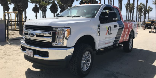 Vehicle modifier XL will begin selling its F-250 hybrid pickup in California after...