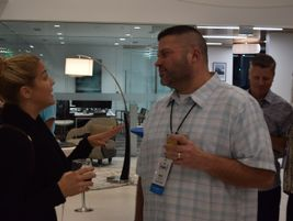 Katie Silverberg, strategic account manager, ARI, chats with Brett Switzky of American Family...