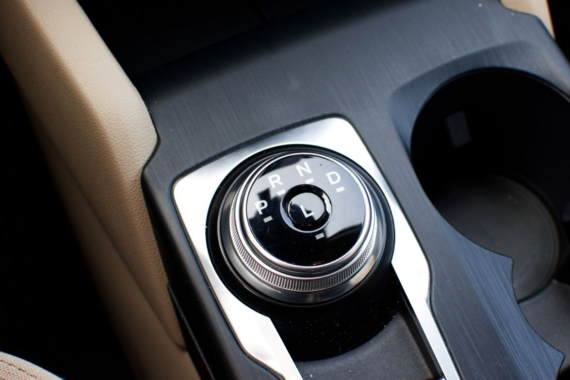 Switching from park, reverse, neutral, and drive is done using a dial.
