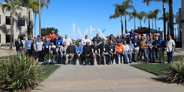 Posing for a group photo during a tour of the Lytx headquarters are some of the 350 attendees at...