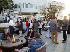 The opening reception was held on the terrace overlooking scenic Coronado Bay and the San Diego...