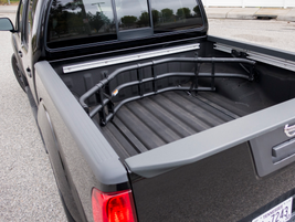 The Value Truck package includes a Utili-track channel system with four adjustable tie-down...