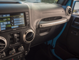 A 6.5-inch touchscreen display shows infotainment controls.