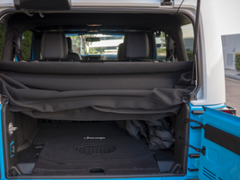 An all-weather subwoofer is mounted in the rear floor.