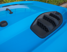 Aggressive vents enhance the hood's styling.