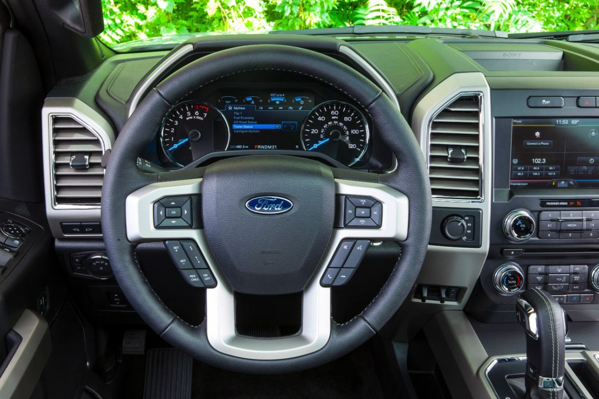 Four-spoke steering wheel:F-150's traditional, four-spoke design allows for a comfortable grip...