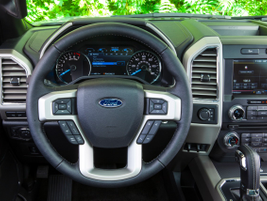 Four-spoke steering wheel: F-150's traditional, four-spoke design allows for a comfortable grip...