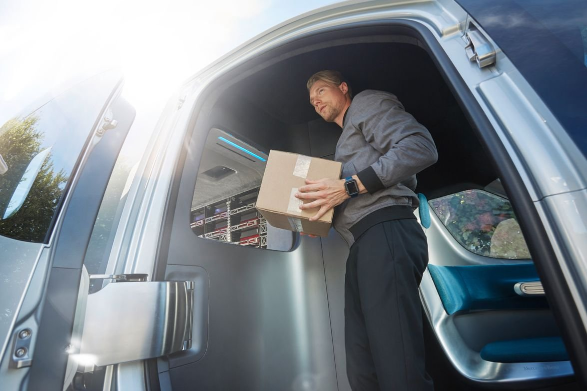 The deliverer takes packages inside the cab from a package dispenser.