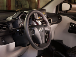 The steering wheel is wrapped in leather and has a flat bottom for added thigh room.