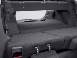 The back seats in the Fusion Hybrid fold down, allowing access to the trunk. Ford said the...