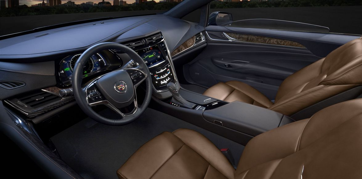 Other interior features include an auto-glide power-assisted covered storage/cup holder in the...